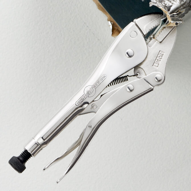 A 10 Inch straight jaw locking pliers clamping on to a piece of HVAC ductwork