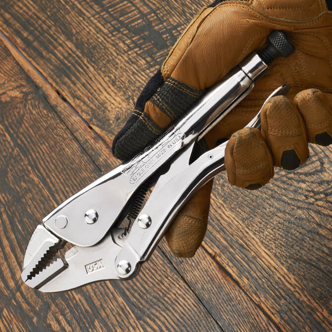 A 10 Inch Eagle Grip Locking Pliers being held by a gloved hand