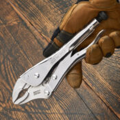 Close up view of a 10 inch Eagle Grip Locking Pliers with curved style jaws being held by a gloved hand