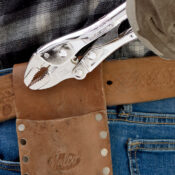 A 10 inch Curved Jaw locking pliers being pulled out of a Malco side pouch