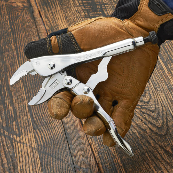 A hand opening a 7 Inch long Eagle Grip Locking Pliers